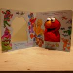 SOFT TOY SESAMI STREET ELMO IN BOOK